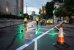 © Licensed to London News Pictures. 13/07/2018. London, UK. Police close Abingdon Street outside the Houses of Parliament and start an investigation after a road accident , understood to have resulted in a woman suffering a serious head injury . Photo credit: Joel Goodman/LNP