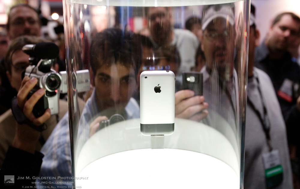 Photographers photograph the newly announced Apple Iphone