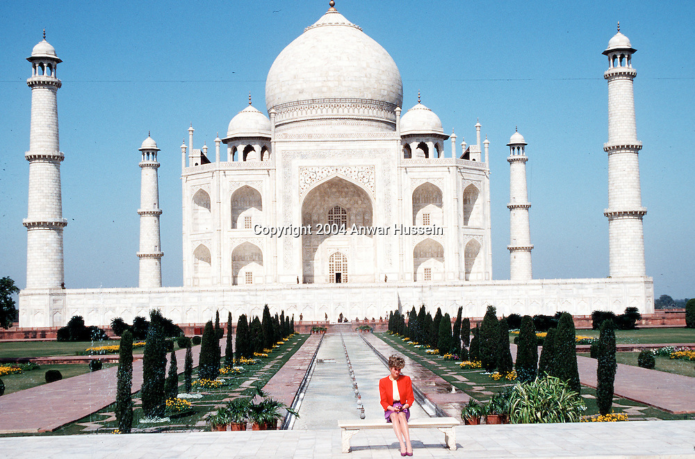 Diana, Princess of Wales shows her lonliness as she poses alone at the Taj Mahal during her visit in India in February 1992.  12 years earlier her husband,  the Prince of Wales, posed in the same spot.   (Photo by Anwar Hussein)