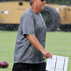 August 9, 2011; Metairie, LA, USA; New Orleans Saints defensive coordinator Gregg Williams  in a rain storm during training camp practice at the New Orleans Saints practice facility. Mandatory Credit: Derick E. Hingle