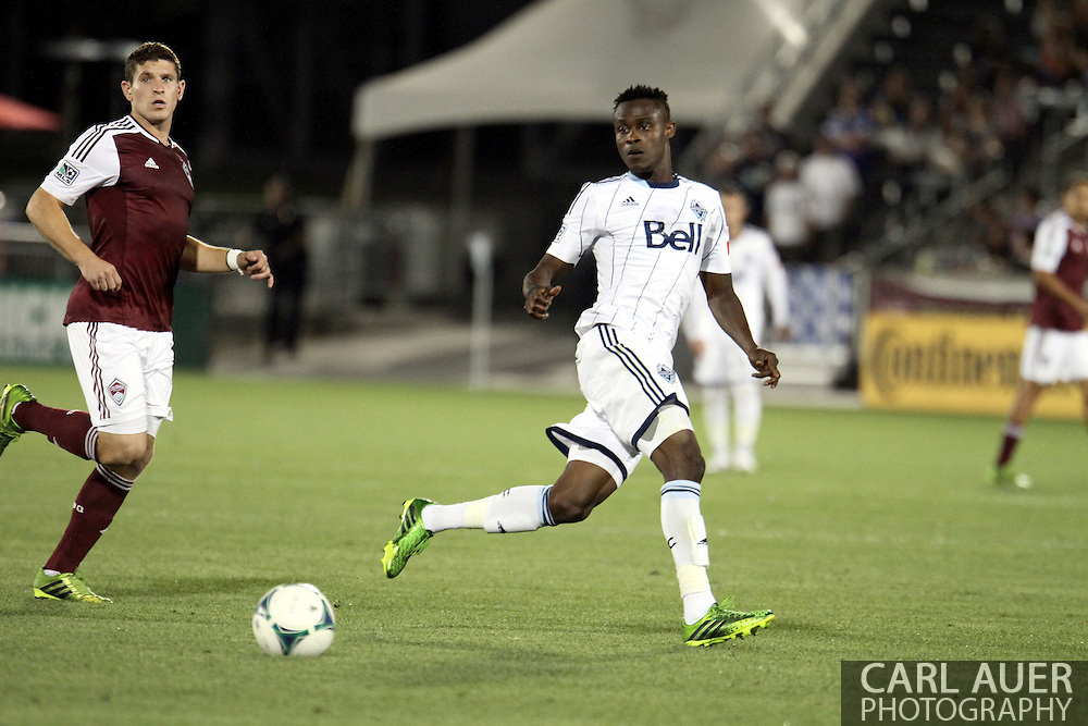 August 17th, 2013 - Vancouver Whitecaps FC midfielder Gershon Koffie (28) passes the ball back away from Colorado Rapids midfielder Dillon Powers (8) in the second half of action in the Major League Soccer match between the Vancouver Whitecaps FC and the Colorado Rapids at Dick's Sporting Goods Park in Commerce City, CO