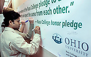 Sudhir Deosaykar, a PhD engineering studet at OU, signs the Honor Pledge in the Stocker Center. photo by Kevin Riddell