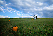VERMONT SEPTEMBER 01, 1999 -- David and Michele Braun walk along a pumpkin trail to their wedding ceremony September 1, 1999 in Vermont. (Photo by Amy Toensing/Getty Images) _________________________________<br />