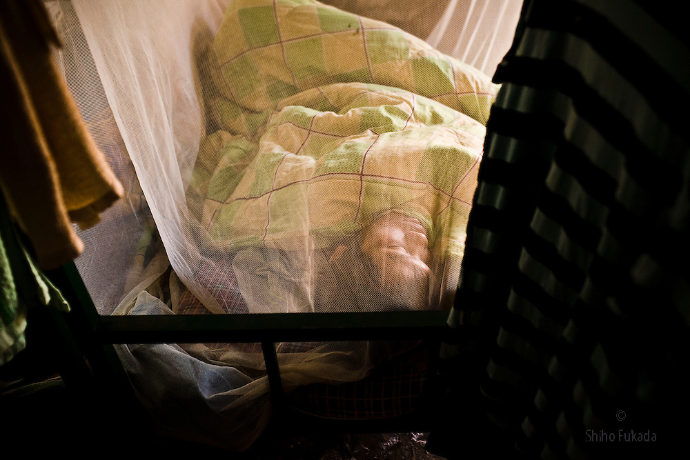 A Chinese worker rests at the dorm near the Haiphong Thermal Power Plant construction site in Trung Son, Vietnam, Nov. 22, 2009. At the construction site here, a few miles northeast of the port city of Haiphong, an entire Chinese world has sprung up, including four walled dormitory compounds for the Chinese workers, restaurants with Chinese signs advertising dumplings and fried rice, and currency exchange shops.