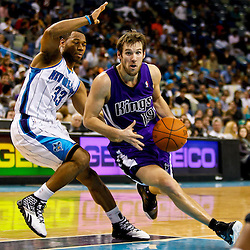 December 15, 2010; Sacramento Kings point guard Beno Udrih (19) drives past New Orleans Hornets shooting guard Willie Green (33) during the second half at the New Orleans Arena. The Hornets defeated the Kings 94-91. Mandatory Credit: Derick E. Hingle