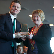"""Queenstown Mayor Vanessa van Uden presents a gift to Brian O""""Driscoll at the Irish teams Civic welcome at Skyline.  Queenstown, New Zealand, 4th September 2011. Photo Tim Clayton.."""