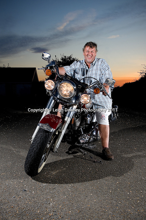 Harley Davidson motor cycle with owner. Photography by Leigh Dawney 2011.