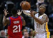 April 21, 2012; Indianapolis, IN, USA; Indiana Pacers power forward David West (21) snags the ball away from Philadelphia 76ers forward Thaddeus Young (21) at Bankers Life Fieldhouse. Philadelphia defeated Indiana 109-106. Mandatory credit: Michael Hickey-US PRESSWIRE