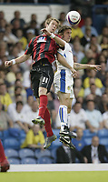 Photo: Aidan Ellis.<br /> Leeds United v Hartlepool United. Coca Cola League 1. 08/09/2007.<br /> Leeds David Prutton (R) challenges Hartlepool's Andy Monkhouse for an aerial ball