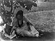 Beatrice Baxter Ruyland and Charles O'Malley, as a child with a book in his lap.  photographic print  [1903] by  Gertrude Käsebier,  1852-1934, photographer.