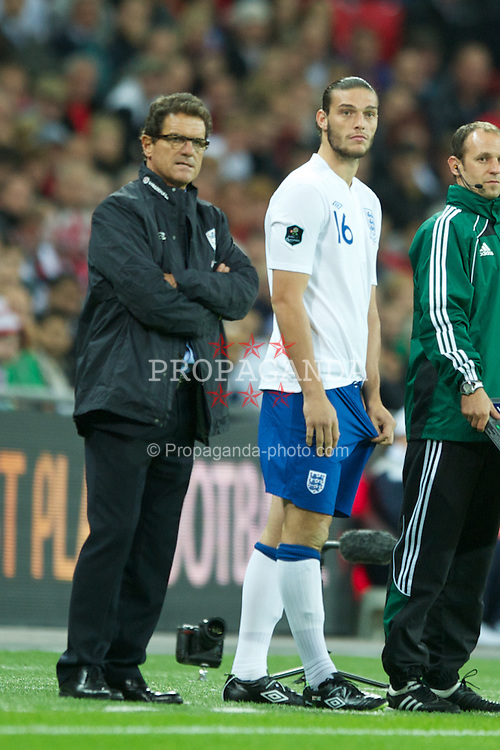 LONDON, ENGLAND - Tuesday, September 6, 2011: England's head coach Fabio Capello with substitute Andy Carroll during the UEFA Euro 2012 Qualifying Group G match against Wales at Wembley Stadium. (Pic by Chris Brunskill/Propaganda)