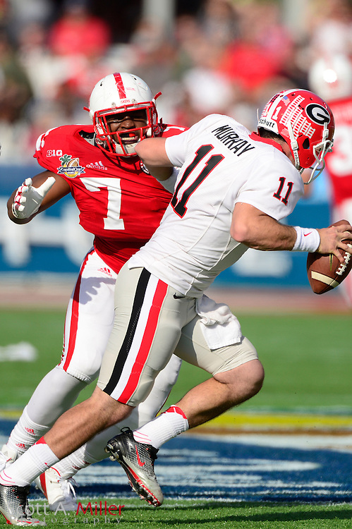 Georgia Bulldogs quarterback Aaron Murray (11) is pressured by Nebraska Cornhuskers defensive end Joseph Carter (7) during the Bulldogs 45-31 win in the Capital One Bowl at the Florida Citrus Bowl on Jan 1, 2013 in Orlando, Florida. ..©2012 Scott A. Miller..