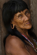 Huaorani Indian  NO MODEL RELEASE<br /> Bameno Community. Yasuni National Park.<br /> Amazon rainforest, ECUADOR.  South America<br /> This Indian tribe were basically uncontacted until 1956 when missionaries from the Summer Institute of Linguistics made contact with them. However there are still some groups from the tribe that remain uncontacted.  They are known as the Tagaeri & Taromenane. Traditionally these Indians were very hostile and killed many people who tried to enter into their territory. Their territory is in the Yasuni National Park which is now also being exploited for oil.