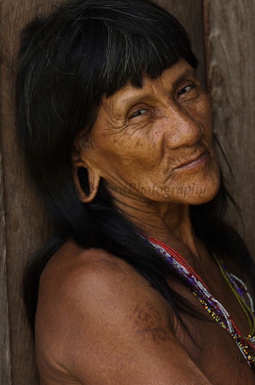 Huaorani Indian  NO MODEL RELEASE<br /> Bameno Community. Yasuni National Park.<br /> Amazon rainforest, ECUADOR.  South America<br /> This Indian tribe were basically uncontacted until 1956 when missionaries from the Summer Institute of Linguistics made contact with them. However there are still some groups from the tribe that remain uncontacted.  They are known as the Tagaeri &amp; Taromenane. Traditionally these Indians were very hostile and killed many people who tried to enter into their territory. Their territory is in the Yasuni National Park which is now also being exploited for oil.
