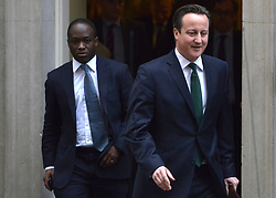 © Licensed to London News Pictures. 18/03/2013. Westminster, UK. Sam Gyimah MP and Parliamentary Private Secretary to the British Prime Minister David Cameron and British Prime Minister David Cameron (right) leaves Downing Street today 18th March 2013. Photo credit : Stephen Simpson/LNP