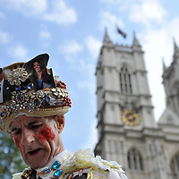 William Willis, the 3rd in line, 3 days early, to see the royal couple emerge from Westminster Abbey on April 29, 2011, interacts with pedestrians in London.