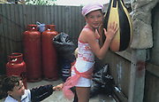 A Doherty sister wearing a pink cap holding a punch bag, Winterbourne Travellers site, Bristol, October 2003