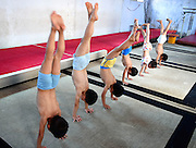 BOZHOU, CHINA - JULY 28: (CHINA OUT) <br /> <br /> Children practice in a gymnastics training session  in Bozhou, Anhui Province of China. Children with some special physical conditions could be selected to do gymnastics training sessions in summer holiday in Bozhou, young children are put through some extreme training sessions , china is know for teaching its Gymnastics to the very young in demanding ways to make sure one day  they reach olympic level.<br /> ©Exclusivepix Media