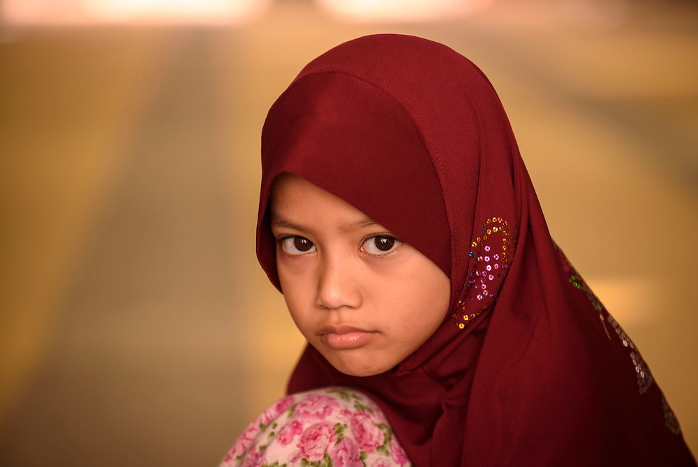 A young Muslim girl at the Malacca Straits Mosque in Malacca, Malaysia.