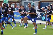 AFC Wimbledon defender Rod McDonald (26) warming up during the EFL Sky Bet League 1 match between AFC Wimbledon and Scunthorpe United at the Cherry Red Records Stadium, Kingston, England on 15 September 2018.