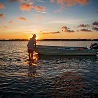 "David ""Clammerhead"" Cessna positions his boat near an oyster bed in Morehead City, North Carolina."