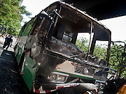 21 MAY 2010 - BANGKOK, THAILAND: A destroyed toilet bus on Rathdamri Road in Bangkok. The bus was being used in the Red Shirt camp and Red Shirts set it afire as Thai troops moved in to clear them out. Clean up continued in Bangkok Friday, two days after the army cleared the streets of anti government protesters.  PHOTO BY JACK KURTZ