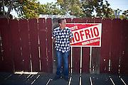 Joe Riofrio, Mendota city councilmember, poses for a portrait next to his closed store, the Westside Grocery in Mendota, Calif., September 10, 2012.