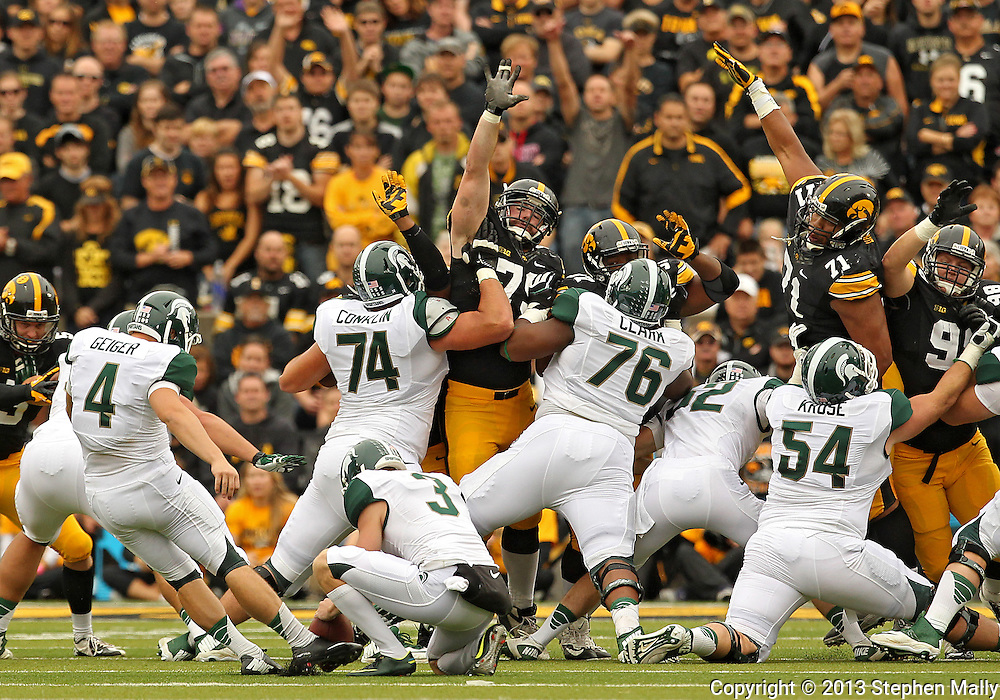 October 6 2013: Michigan State Spartans kicker Michael Geiger (4) attempts a field goal from the hold of Michigan State Spartans punter Mike Sadler (3) during the first quarter of the NCAA football game between the Michigan State Spartans and the Iowa Hawkeyes at Kinnick Stadium in Iowa City, Iowa on October 6, 2013. Michigan State defeated Iowa 26-14.