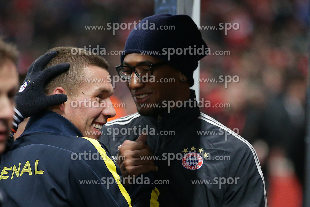 19.02.2013, Emirates Stadion, London, ENG, UEFA Champions League, FC Arsenal vs FC Bayern Muenchen, Achtelfinale Hinspiel, im Bild, Jerome BOATENG (FC Bayern Muenchen - 17) und Lukas PODOLSKI (FC Arsenal London - 9) liegen sich in den Armen vor dem Spiel // during the UEFA Champions League last sixteen first leg match between Arsenal FC and FC Bayern Munich at the Emirates Stadium, London, Great Britain on 2013/02/19. EXPA Pictures © 2013, PhotoCredit: EXPA/ Eibner/ Gerry Schmit..***** ATTENTION - OUT OF GER *****
