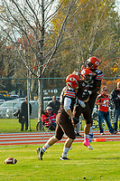 KELOWNA, CANADA - OCTOBER 21: Aiden Hennessey #35 and Jesse Amankwaa #32 celebrate the touchdown with Kian Ishani #8 of the Okanagan Sun against the Chilliwack Huskers during BCFC Semi-Final play on Sunday, October 21, 2018, at the Apple Bowl, in Kelowna, British Columbia, Canada.  (Photo by Marissa Baecker/Shoot the Breeze)  *** Local Caption ***