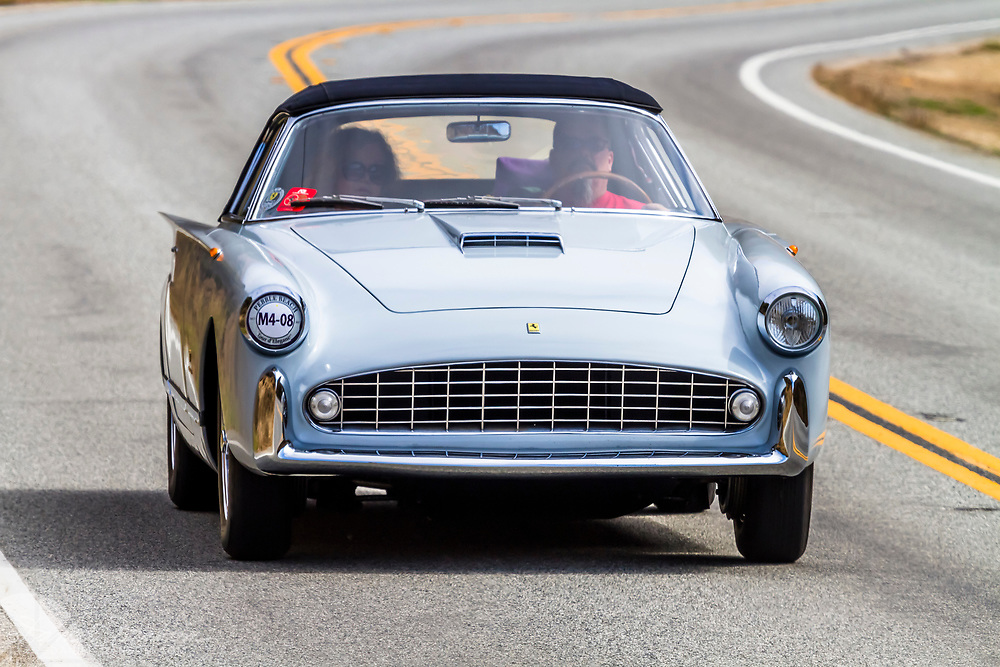 1956 Ferrari 410 Superamerica Boano Cabriolet, in the Tour d Elegance, along Highway 1 on the Big Sur Coast. Classic and Historic autos participate in the Pebble Beach, Concours d Elegance, take to the highway to tour the Monterey Peninsula and coast.