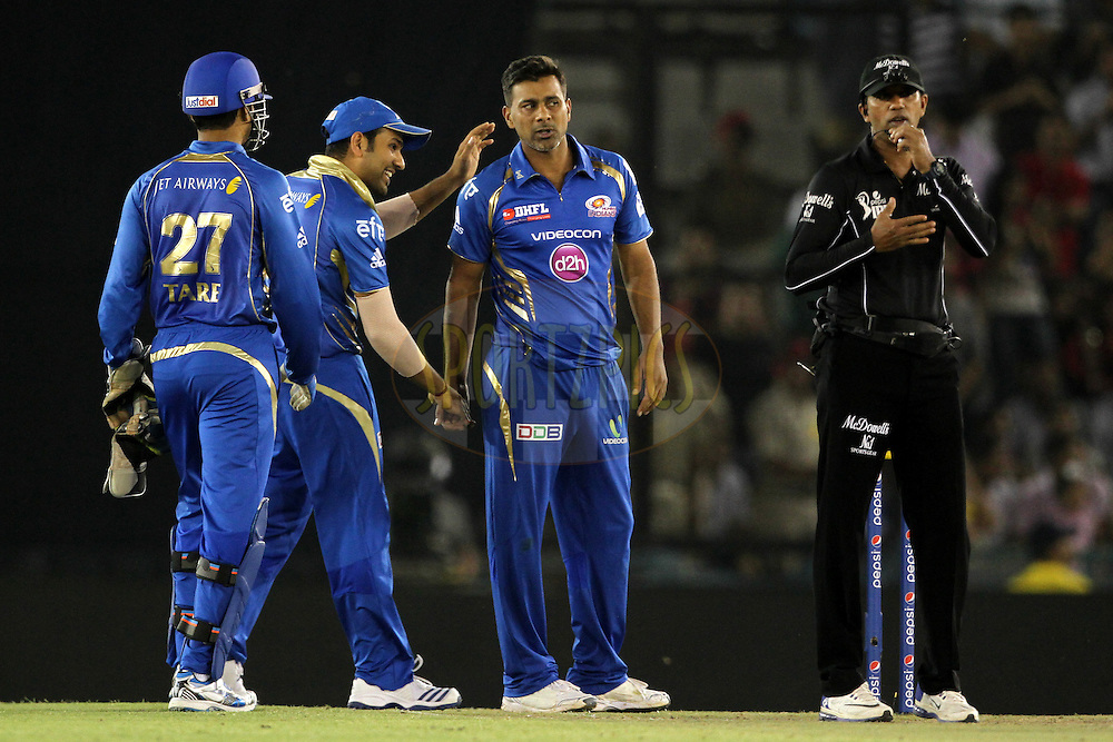 Rohit Sharma , Parveen Kumar of the Mumbai Indians celebrates the wicket of Akshar Patel of the Kings X1 Punjab during match 48 of the Pepsi Indian Premier League Season 2014 between the Kings XI Punjab and the Mumbai Indians held at the Punjab Cricket Association Stadium, Mohali, India on the 21st May  2014<br /> <br /> Photo by Deepak Malik / IPL / SPORTZPICS<br /> <br /> <br /> <br /> Image use subject to terms and conditions which can be found here:  http://sportzpics.photoshelter.com/gallery/Pepsi-IPL-Image-terms-and-conditions/G00004VW1IVJ.gB0/C0000TScjhBM6ikg