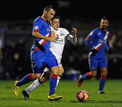 Brad Ash of Weston Super Mare closes down Doncaster Rovers' Luke McCullough - Photo mandatory by-line: Dougie Allward/JMP - Mobile: 07966 386802 - 18/11/2014 - SPORT - Football - Weston-super-Mare - Woodspring Stadium - Weston Super Mare v Doncaster Rovers - FA Cup