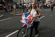 London, 10th September 2012. Olympic fan leaves the athletes' parade in the City of London. The day after the end of the London 2012 Paralympics, thousands of spectators lined the capital's streets to honour 800 of TeamGB's athletes and Paralympians. Britain's golden generation of athletes in turn said thank you to its Olympic followers, paying tribute to London and a wider Britain as up to a million people lined the streets to celebrate the ?greatest ever? sporting summer and billed to be the biggest sporting celebration ever seen in the UK.