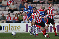 Photo: Pete Lorence.<br />Lincoln City v Stockport County. Coca Cola League 2. 07/04/2007.<br />Wayne Hennessey and Lee Beevers battle for the ball.