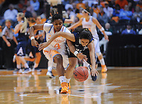 Nov 15, 2012; Knoxville, TN, USA; Tennessee Lady Volunteers guard Kamiko Williams (4) knocks the ball away from Rice Owls guard Reem Moussa (23) at Thompson Boling Arena. Tennessee won by a score of 101 to 48. Mandatory Credit: Randy Sartin-US PRESSWIRE