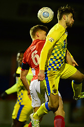 STOCKPORTS JASON OSWELL BATTLES WITH BRACKLEYS GARETH DEAN, Brackley Town v Stockport County, Buildbase FA Trophy 4th Round Replay, Tuesday 6th March 2018 Score 2-1 <br /> Photo:Mike Capps