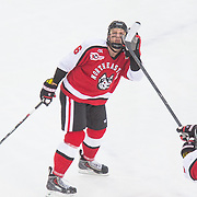 during the Frozen Fenway game between The Northeastern Huskies and The UMass Lowell Riverhawks at Fenway Park on January 11, 2014 in Boston, Massachusetts.