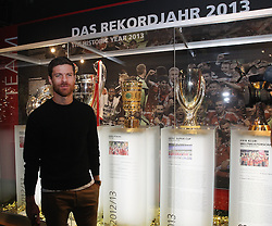14.10.2014, Allianz Arena, M&uuml;nchen, GER, 1. FBL, FC Bayern Muenchen, Xabi Alonso, im Bild Xabi Alonso (FC Bayern M&uuml;nchen) vor den Troph&auml;enschrank // FC Bayern Munich player Xabi Alonso visits the FC Bayern Erlebniswelt Museum at the Allianz Arena in M&uuml;nchen, Germany on 2014/10/14. EXPA Pictures &copy; 2014, PhotoCredit: EXPA/ Eibner-Pressefoto/ FCB/Getty Pool<br /> <br /> *****ATTENTION - OUT of GER*****