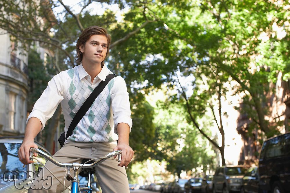 Man riding bicycle in residential district