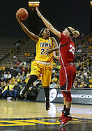February 11 2013: Iowa Hawkeyes guard Theairra Taylor (23) puts up a hook shot over the arm of Nebraska Cornhuskers forward Emily Cady (23) during the first half of the NCAA women's basketball game between the Nebraska Cornhuskers and the Iowa Hawkeyes at Carver-Hawkeye Arena in Iowa City, Iowa on Monday, February 11 2013.