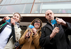 © licensed to London News Pictures. London, UK 27/04/2012. Protesters cutting their Barclays debit cards outside Royal Festival Hall to protest against Barclays AGM today (27/04/12). Photo credit: Tolga Akmen/LNP