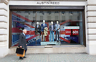 A man walks past the Regent Street branch of menswear retailer Austin Reed, which is entering administration putting 1200 jobs at risk. Westminster, London.<br /> Picture by Paul Davey/Focus Images Ltd +447966 016296<br /> 26/04/2016