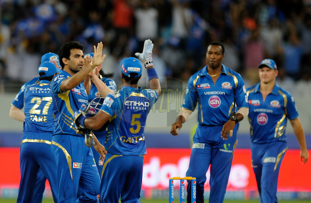 Zaheer Khan of the Mumbai Indians celebrates the wicket of Aaron Finch of the Sunrisers Hyderabad during match 20 of the Pepsi Indian Premier League Season 2014 between the Mumbai Indians and the Sunrisers Hyderabad held at the Dubai International Stadium, Dubai, United Arab Emirates on the 30th April 2014<br /> <br /> Photo by Pal Pillia / IPL / SPORTZPICS