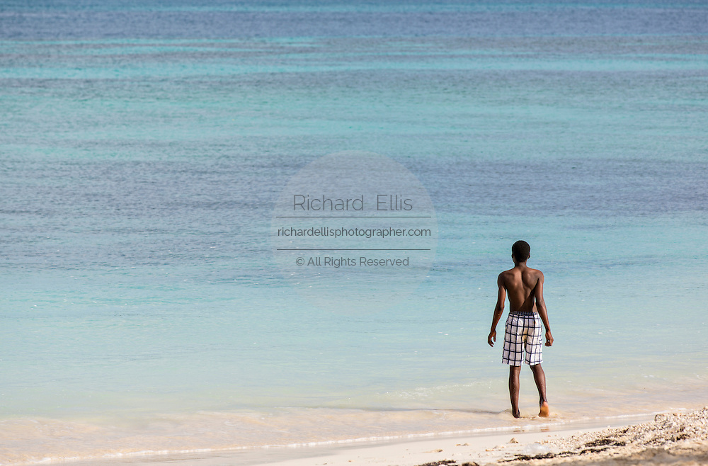 A young boy enjoys Junkanoo beach Nassau, Bahamas, Caribbean