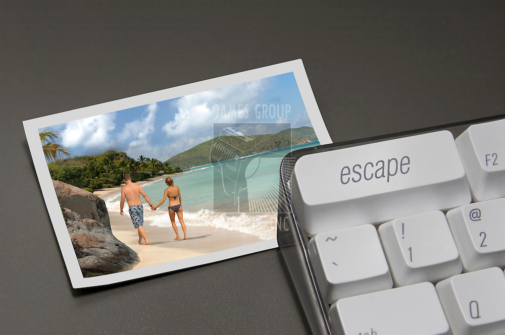 "close up of ""escape"" key on a computer keyboard with a photo of a tropical paradise next to it"