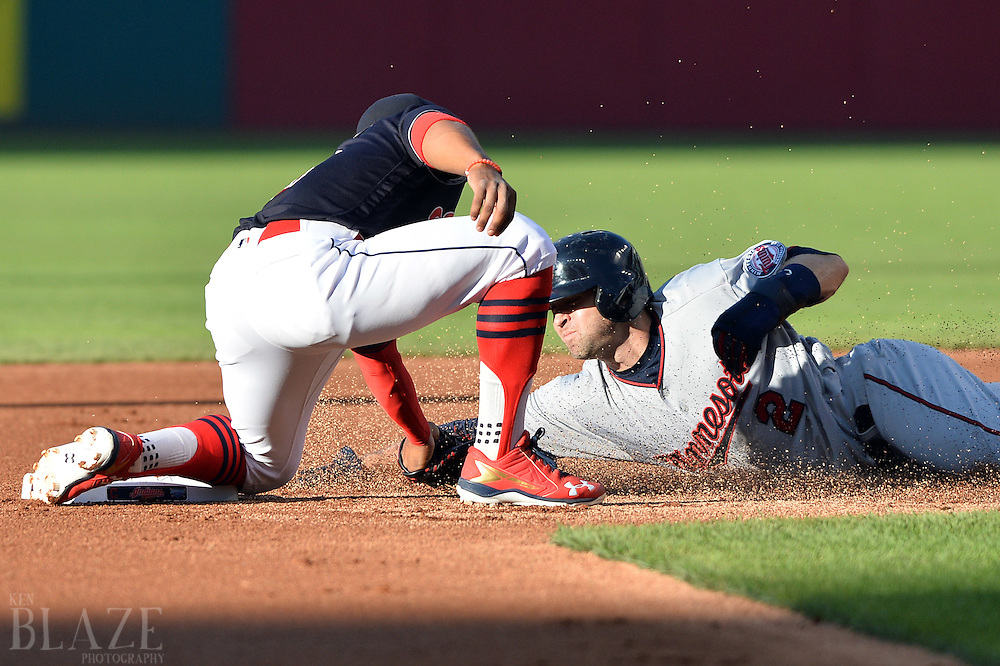 Aug 1, 2016; Cleveland, OH, USA; Minnesota Twins second baseman Brian Dozier (2) is caught stealing by Cleveland Indians shortstop Francisco Lindor (12) during the first inning at Progressive Field. Mandatory Credit: Ken Blaze-USA TODAY Sports