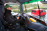 DEU, Germany, truck driver [the carny Alexander Pluschies conveys his ride Rotor to the next fun fair]. <br /> <br /> DEU, Deutschland, Lastkraftwagenfahrer [der Schausteller Alexander Pluschies transportiert sein Fahrgeschaeft Rotor zur naechsten Kirmes].