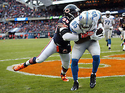 Detroit Lions tight end Eric Ebron (85) catches a one yard touchdown pass good for a 24-17 fourth quarter Lions lead while covered by Chicago Bears rookie free safety Adrian Amos (38) during the NFL week 17 regular season football game against the Chicago Bears on Sunday, Jan. 3, 2016 in Chicago. The Lions won the game 24-20. (©Paul Anthony Spinelli)