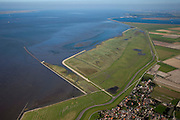 Nederland, Friesland, Gemeente Dongeradeel, 08-09-2009; Peazemerlannen, kweldergebied grenzend aan het Wierumerwad en de Waddenzeee. Onder in beeld het tweeling-dorp Paesens-Moddergat, aan de verre horizon het Lauwersmeer. Het buitendijkse natuurgebied, in beheer bij  It Fryske Gea, is ontstaan door spontane uitpoldering bij een zware storm in 1973 waarbij er een gat geslagen werd in de bitumendijk. .The village Paesens and Peazemerlannen, salt marshes bordering the Wierumerwad and Waddenzeee. The area has been created in 1973, a severe storm made a hole in the outside polder dike. The area is a nature reserve, managed by It Fryske Gea.luchtfoto (toeslag); aerial photo (additional fee required); .foto Siebe Swart / photo Siebe Swart